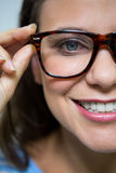 Female customer wearing spectacles in optical store Royalty Free Stock Image
