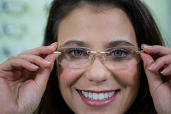 Female customer wearing spectacles in optical store Royalty Free Stock Photos