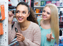 Female customers choosing mascara Royalty Free Stock Photo