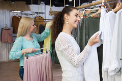 Female customers looking for new garments Royalty Free Stock Photography