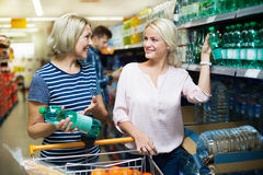 Female customers purchasing water in hypermarket Stock Images