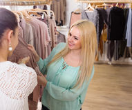 Female customers selecting basic garments Stock Photography