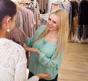 Female customers selecting basic garments Stock Photography
