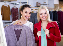 Female customers selecting coats and jackets Stock Photography