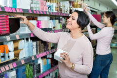 Female customers selecting skincare products Stock Photography