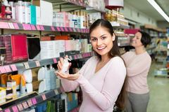 Female customers selecting skincare products Stock Images