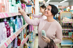Female customers selecting skincare products Royalty Free Stock Images