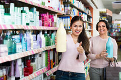 Female customers selecting skincare products Royalty Free Stock Image