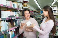 Female customers selecting skincare products Royalty Free Stock Photography