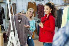 Female customers shopping winter outwear Royalty Free Stock Photos