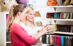 Female customers in store shopping looking for wallets and purse. S Royalty Free Stock Image