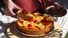 Female cut pie with oranges for a event day on picnic chacked llitter. stock footage