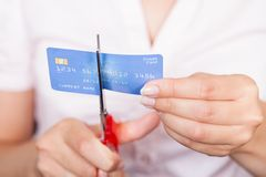 Female Cutting Credit Card Stock Images