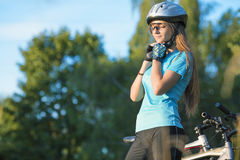 Female Cycling Athlet in Professional Cycling Gear Outdoor. Horizontal Image royalty free stock photos