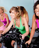Female cycling in fitness club Royalty Free Stock Images