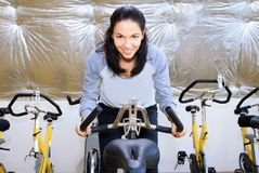 Female during cycling traning. Royalty Free Stock Photos