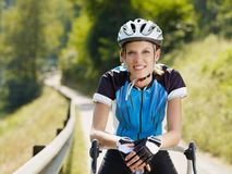 Female cyclist Stock Images