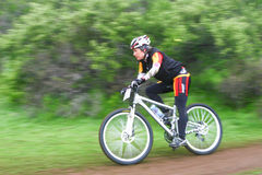 Female cyclist Royalty Free Stock Images