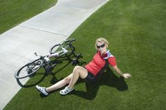 Female Cyclist With Bicycle Relaxing In Park Royalty Free Stock Images