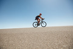 Female cyclist on a country road training for triathlon Royalty Free Stock Image
