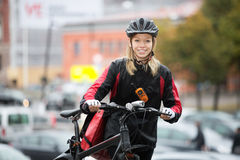 Female Cyclist With Courier Bag On Street Royalty Free Stock Image