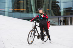 Female Cyclist With Courier Delivery Bag Using Royalty Free Stock Photo