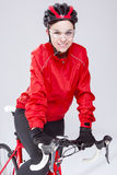 Female Cyclist Equipped in Cycling Outfit and Posing With Road Bike Stock Image