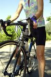 Female Cyclist with Flowered Jersey. Woman on road bike with sleaveless jersey Stock Photo
