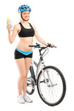 Female cyclist holding a water bottle Royalty Free Stock Images