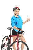 Female cyclist holding a water bottle Royalty Free Stock Image