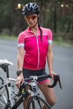 Female cyclist outdoors Stock Photo
