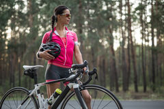 Female cyclist outdoors Stock Images