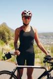 Female cyclist preparing for triathlon Royalty Free Stock Images