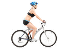 Female cyclist riding a bike Stock Photos