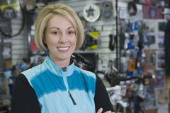 Female Cyclist In Shop Royalty Free Stock Images