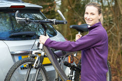 Female Cyclist Taking Mountain Bike From Rack On Car Stock Images