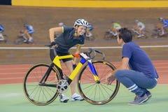 Female cyclist training on velodrome. Female cyclist training on a velodrome Royalty Free Stock Photo