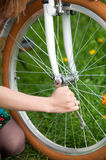 Female cyclist with vintage white bicycle in spring garden Royalty Free Stock Photo