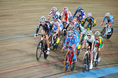 Female cyclists ride on track Stock Photo