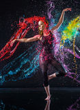 Female Dancer Being Splashed with Colorful Water Stock Image