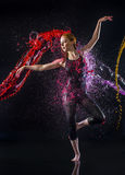 Female Dancer Being Splashed with Colorful Water Royalty Free Stock Photos