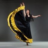 Female dancer in black dress Stock Photo