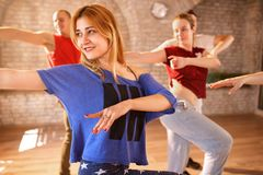 Female dancer dancing with group. In studio royalty free stock photography