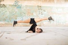 Female dancer doing a leg split Stock Images