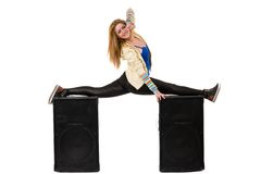 Female dancer doing the splits on two speakers Royalty Free Stock Image