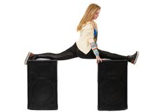 Female dancer doing the splits on two speakers Royalty Free Stock Photography