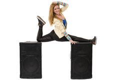 Female dancer doing the splits on two speakers Royalty Free Stock Photos