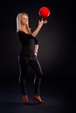 Female dancer exercising with ball Stock Photography