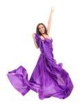 Female dancer in flying purple dress Stock Photo
