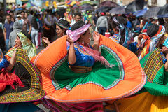 Female dancer group in Pujili Ecuador. June 17, 2017 Pujili, Ecuador: female dancer group in traditional clothing in motion at the Corpus Christi annual parade stock image